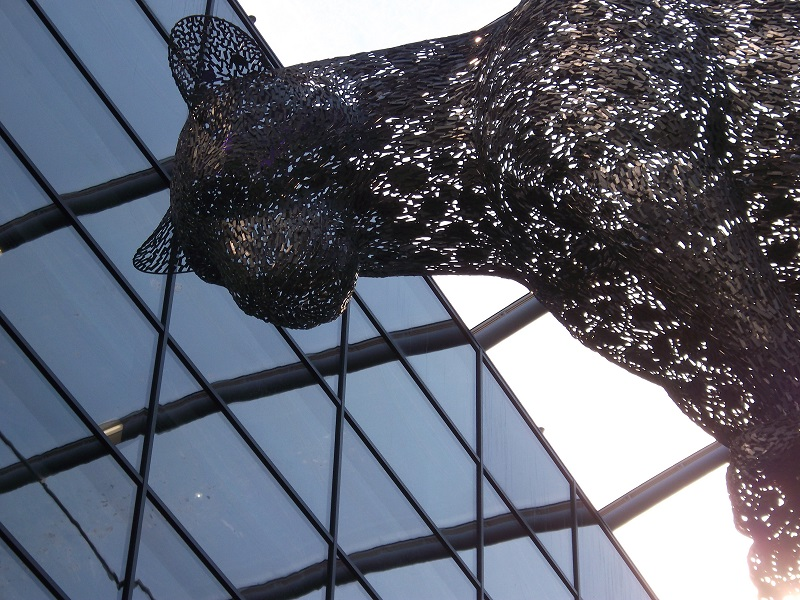 View from below of giant leopard statue