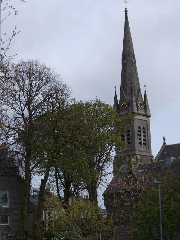 Ferryhill Parish Church clock tower, seen through trees